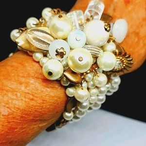 6 strand fun bracelet, pearls and beads.
